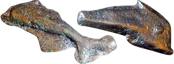 Изображение древней монеты в форме дельфинов